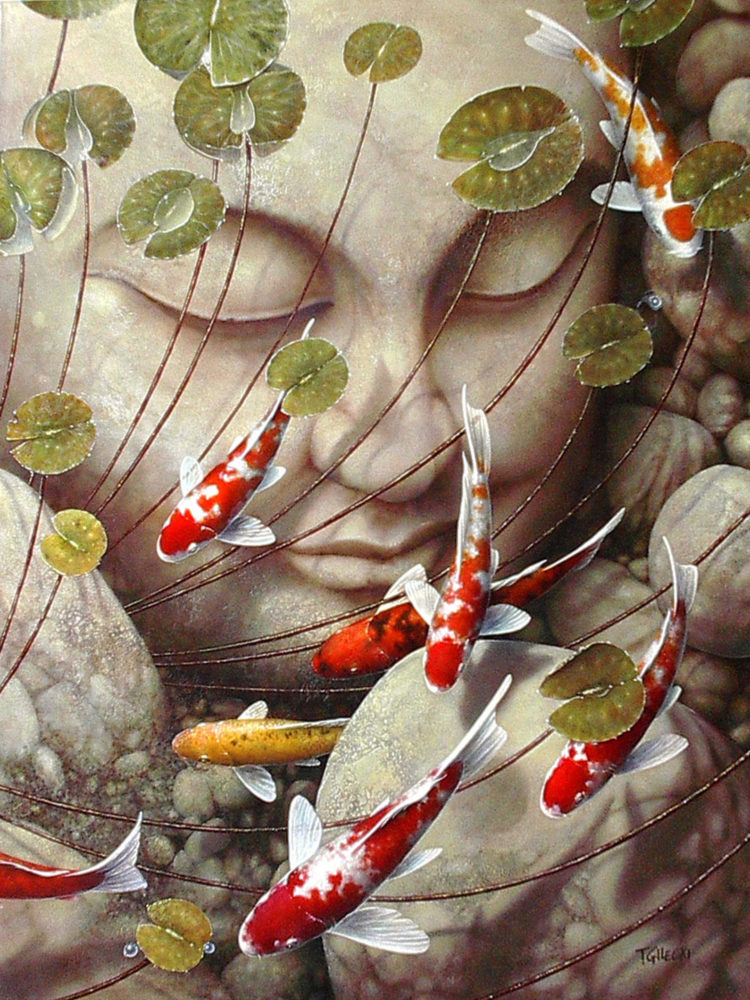 koi swimming by buddah face in pond