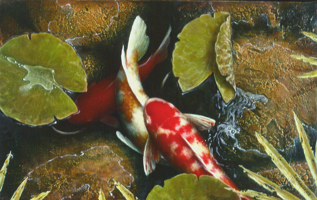 3 koi fish and rocks